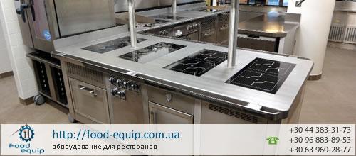Плита профессиональная промышленная электрическая на кухне ресторана